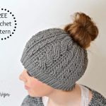 Free Crochet Pattern – Crochet Cabled Messy Bun Hat (Adult Sizes) (video tutorial included)